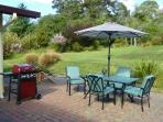 Back yard dining, and gas barbeque.