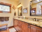 The bathroom counters are custom granite. The walls are decorated vintage Texas hill country.
