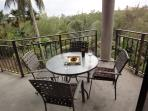 the deck has a table and 6 chairs plus 2 chaise lounges and 2 small side tables