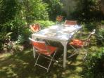 Welcome to Riverside Cottage.  The sunny flower garden for afternoon shade and al fresco dining.