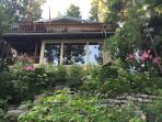Surrounded by beautiful gardens, south side of the house facing Donner Lake and Donner Pass Road.