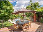 Deck overlooking solar heated swimming pool
