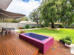 Outdoor heated bath and large garden with expansive decking, outdoor dining, bbq and sun awning