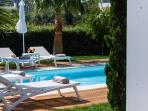 Relax by the pool all day long, under the shade of the trees!