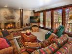 Family room with fireplace, sofa sleeper, seats 6. Walk out to hot tub.