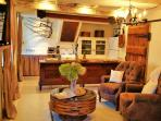 A cozy living area with wifi, reclining chairs, satellite t.v. and original mill door.