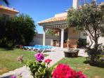 This beautiful Meditteranean style villa is set in lovely gardens,
