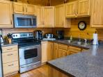 Kitchen: Glass Top Stove, Microwave, Keurig K450 Brewer, Blender, Coffee Maker, Toaster, Crock Pot.