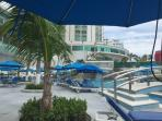 Restaurant view of the pool and private umbrella tables for your enjoyment.  Food and drinks for you