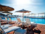 large sea water pool beach club and restaurant, 2 minutes walk from villa