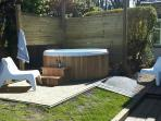 The Hot tub is in a sunny corner of the garden