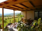 The covered terrace facing west and the garden with magnificent views over the countryside