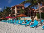 Enjoy private loungers, umbrellas & beach service