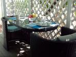 Intimate, comfortable seating for two on shaded deck. Wonderful for breakfast.
