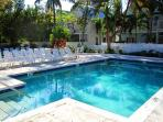 Relax by the pool within a one-minute walk from Shabby Chicken condo