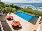 2nd level view of pool and  coastline