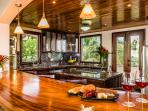 Hardwood bar floats between family room and kitchen