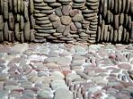 Stone mosaics at cottage