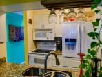 Open concept kitchen with all the amenities of home; blender, spices, wine glasses, cutlery, stocked