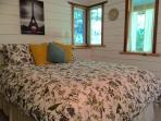 Queen bed in downstairs private bedroom