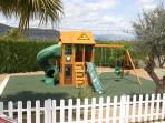 Dedicated children's play area with picket fencing