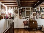The Bedroom with the collection of old paintings and old reproductions of famous sacred images.