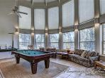 This room features a sleeper sofa and a pool table
