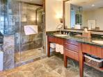 First master bath has a dual vanity, luxurious walk-in shower, and soaking tub