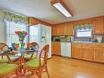 Head into the kitchen and dining area.
