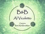 Il Logo.  Al Vicoletto si trova al centro della condivisione del sapere, un luogo di scambio.