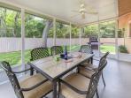 Enjoy a meal or some Scrabble in the screened lanai
