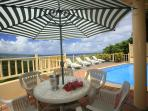 Enjoy relaxing on the terrace by the pool with the panoramic views of the Caribbean and Castries