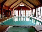 Indoor heated pool with hot tub and two saunas
