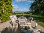 Alfresco dining on the south facing terrace overlooking the Cotswold hills