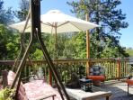 Comfortable glider, shade from market umbrellas, great views, privacy.
