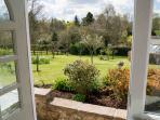 A view of Valley Farm's guest garden/orchard from Plough Cottage
