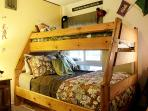 Bedroom has full on bottom, twin on top and another bunk bed.
