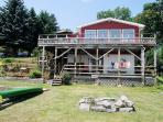 View of the back of the house. Upper and lower deck, newly built stairs and grilling deck. Fire pit!