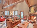 Vaulted ceilings, rustic decor, and a wood-burning fireplace highlight this home