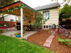 Open patio with comfortable outdoor furniture, coffee tables, patio lights, bluetooth speaker