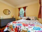 Bedroom #1: Spacious bedroom with queen bed, dresser, ceiling fan, TV and Roku