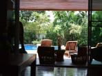 lounge opening to swimming pool