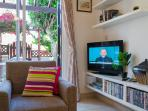 Television with satellite box and DVD collection