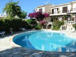 A communal swimming pool is located on the complex only a few metres away from the townhouse