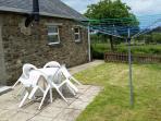 Enclosed rear garden with patio furniture