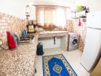 Kitchen with frigo, washing machine etc