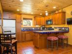 Cherry Cabinets with all Mexican tile.