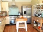Large family kitchen with  Range master cooker and American style fridge freezer.