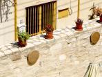 Romios Apartments Court yard Wall