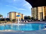 The resort with kiddie pool in adult pool in foreground.
